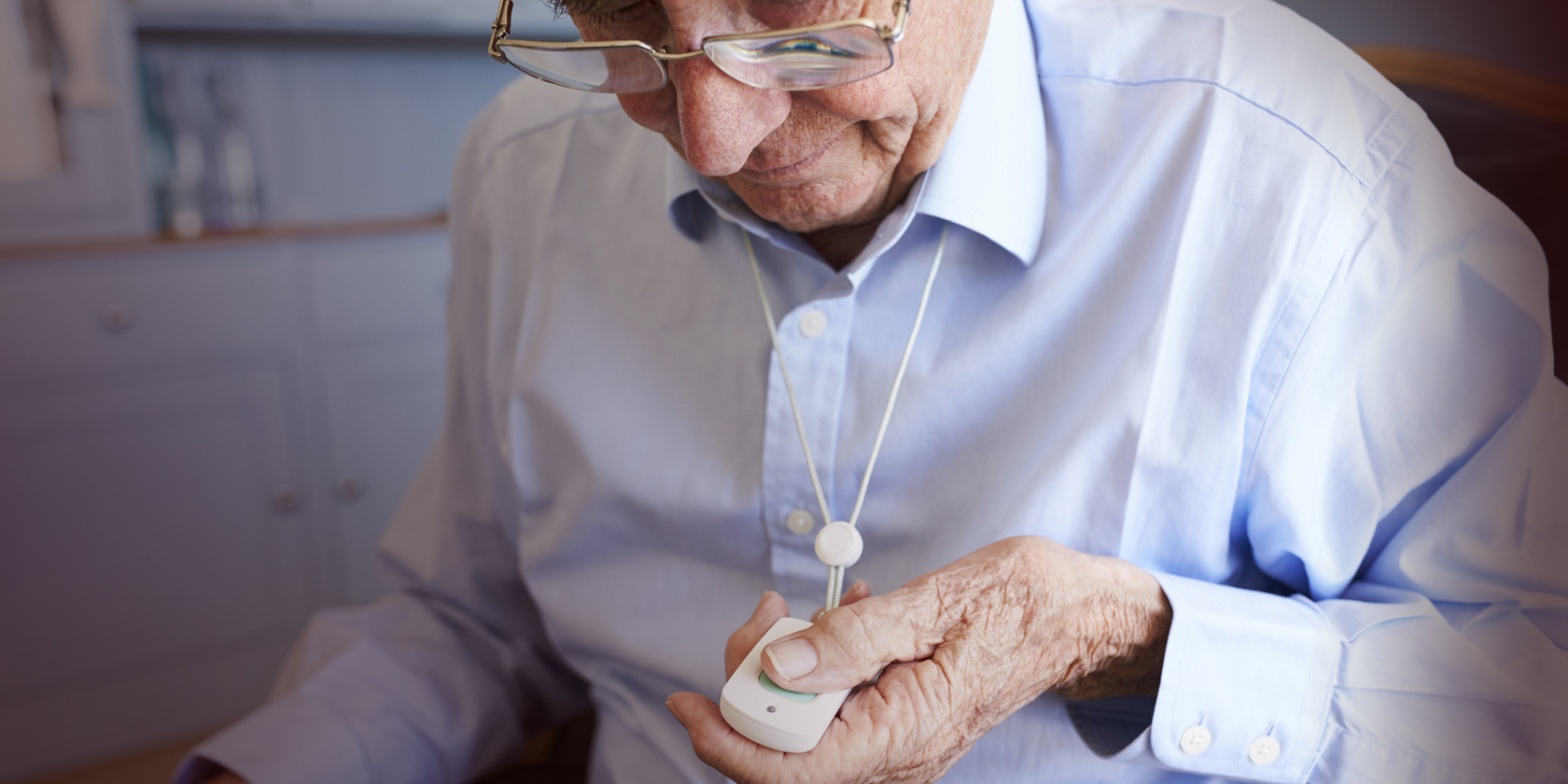 old man with pendent alarm